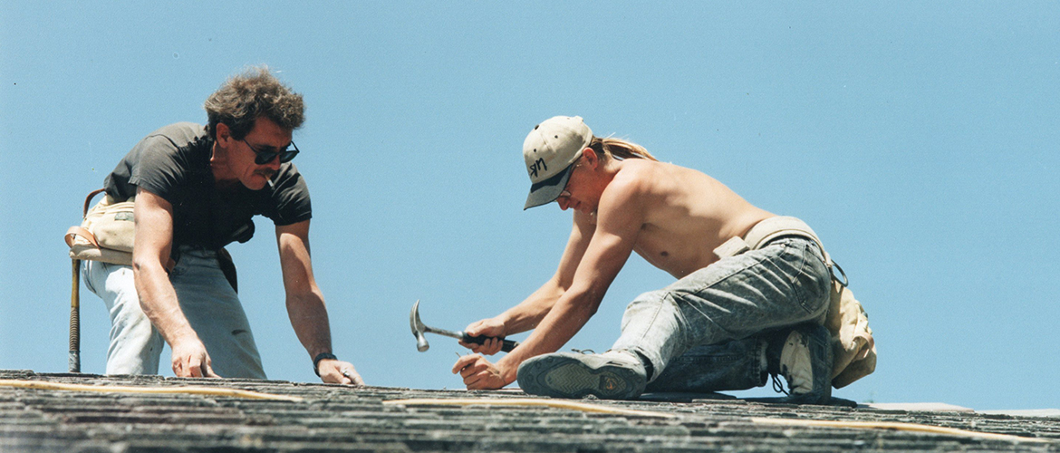 Habitat for Humanity volunteers on a roof